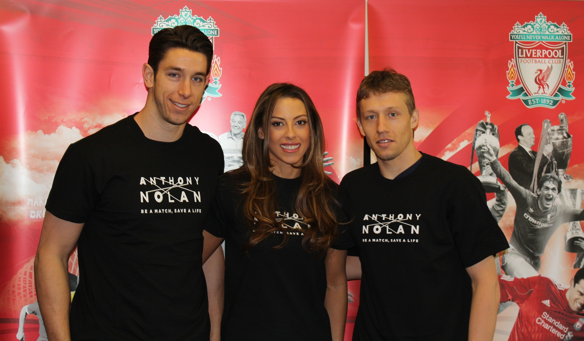 1 - (L-R) LFC goalkeeper, Brad Jones and partner Dani Lawrence with Lucas Leiva supporting the Anthony Nolan recruitment drive at Anfield on 25 March