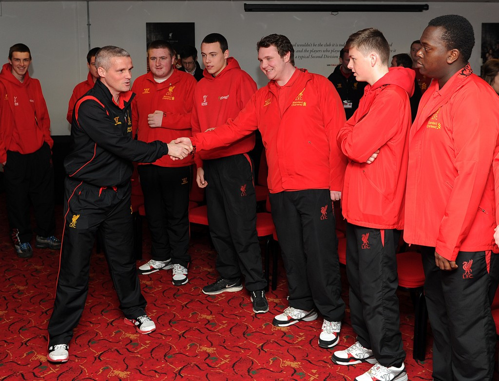 1 - LFC First Team Coach Mike Marsh greeting the LFC Youth Ambassadors at Anfield