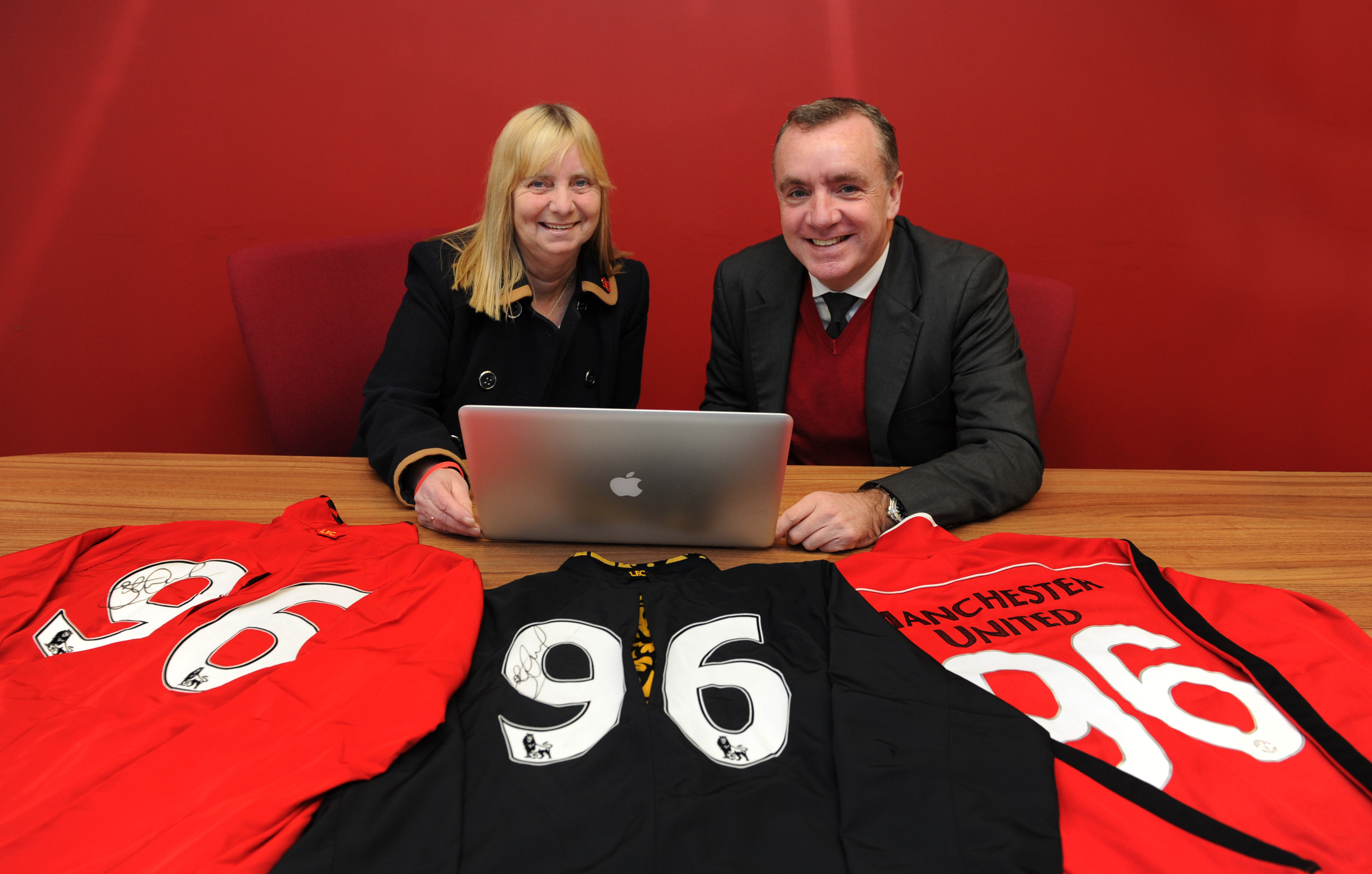 1 - Margaret Aspinall, Chair of Hillsborough Family Support Group and Ian Ayre, Liverpool FC's Managing Director launching the auction, with three of the '96' jackets