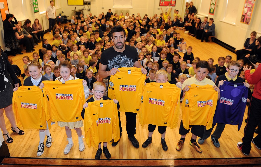 1 - LFC defender, Jose Enrique, donating football kit to children at Pin...