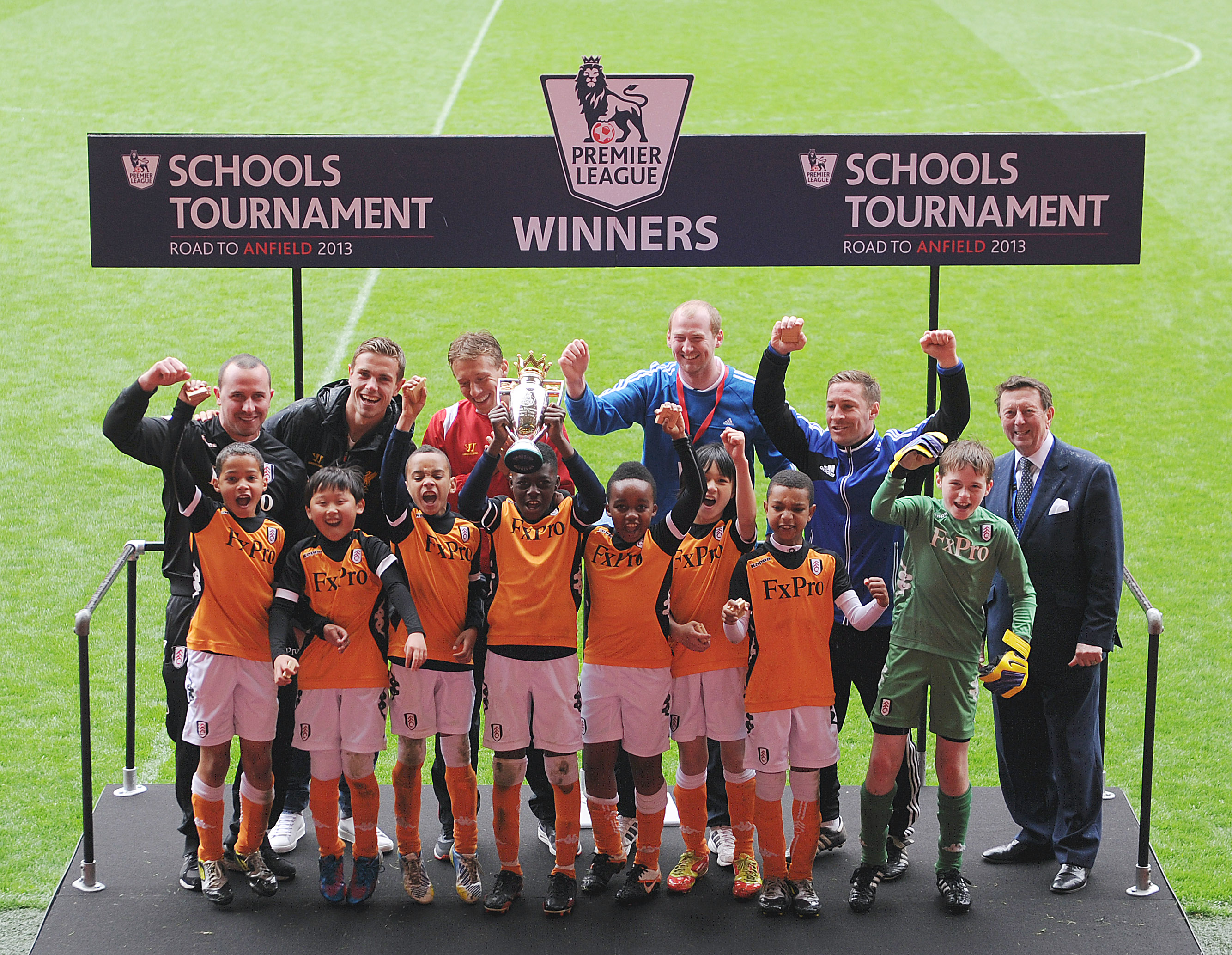 1-Liverpool FC stars,Lucas Leiva&Jordan Henderson, presenting the trophy to Corpus Christi Primary School who represented Fulham FC at Anfield