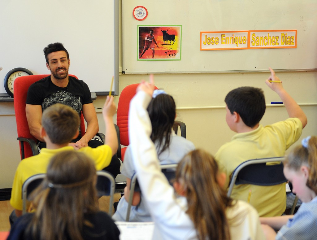 2-LFC defender, Jose Enrique, hosting a Spanish class with children at P...