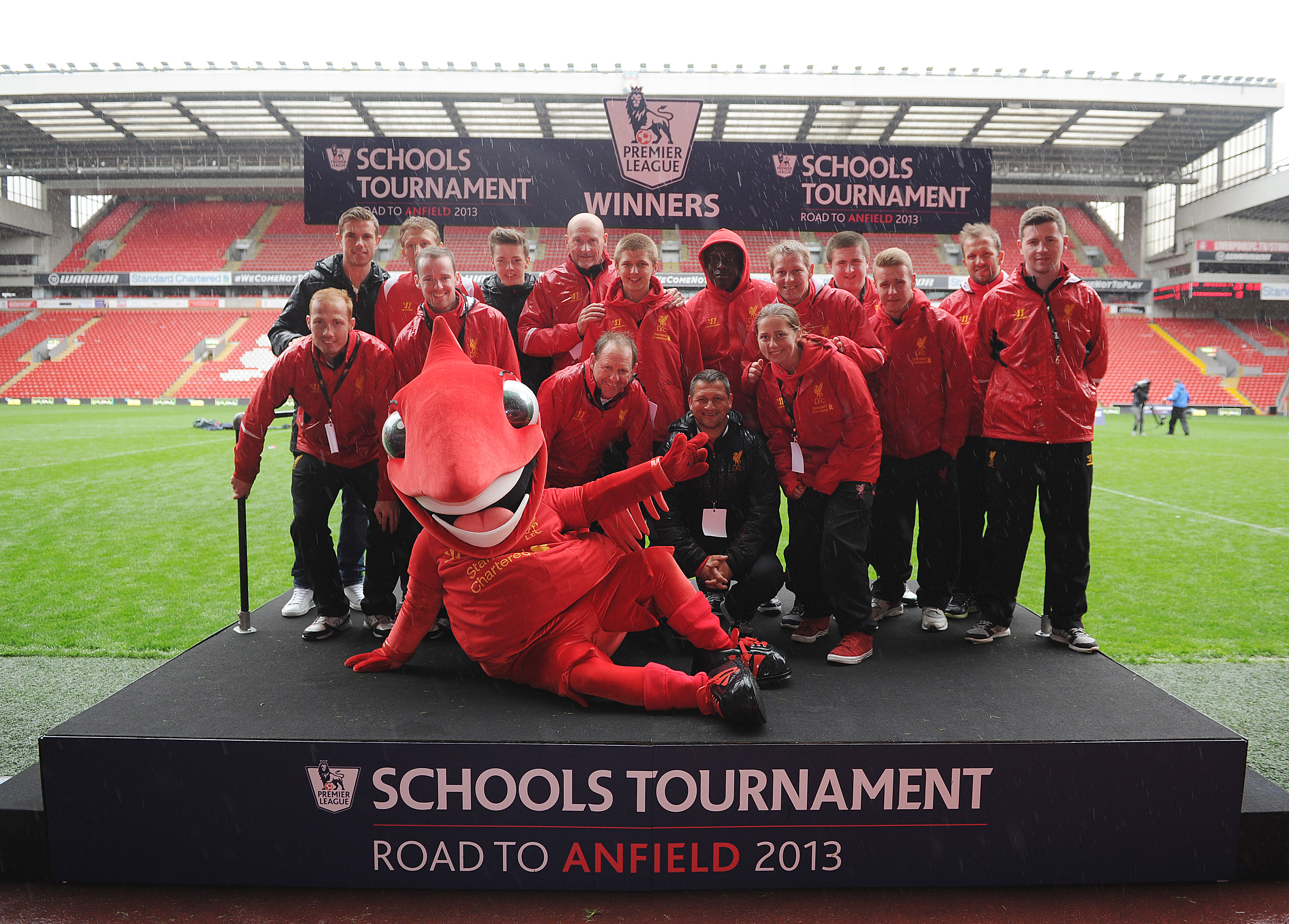 3-LFC stars, Jordan Henderson and Lucas Leiva, join Liverpool FC Foundation Youth Ambassadors&LFC mascot,Mighty Red,on the podium at Anfield
